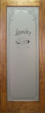 "Laundry room door has ""Laundry"" etched in glass panel.  Shown here in a stained pine frame."